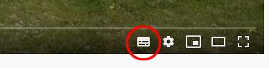 Bild som visar vilken knapp man ska trycka på för att slå på textningen